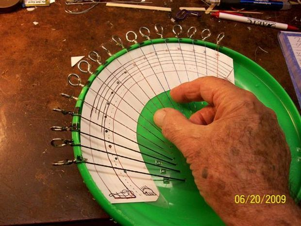 MAKE A MINI-HARP FROM A PLASTIC THROWING DISC style