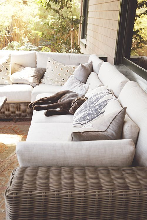 Love the wicker porch sectional...could definitely see a four legged friend taking advantage of the seating... lol. :)