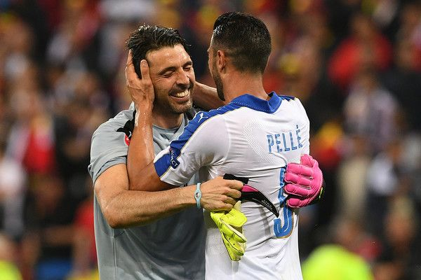 Italy's forward Pelle (R) celebrates with Italy's goalkeeper Gianluigi Buffon after scoring during the Euro 2016 group E football match between Belgium and Italy at the Parc Olympique Lyonnais stadium in Lyon on June 13, 2016. / AFP / VINCENZO PINTO