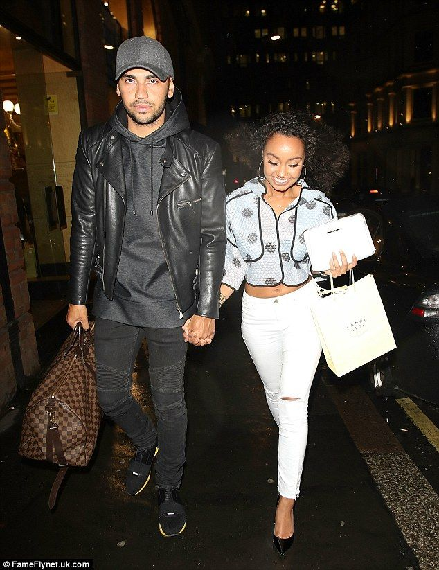 Hand in hand: Leigh-Anne couldn't hide her smile as she walked with theAshford Town FC footballer