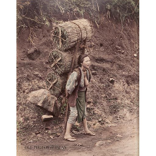 1890's. Woman Delivering Charcoal. A very cheerful woman, with one of her breasts exposed, is carrying three huge packs of charcoal on what appears to be a country road. During the summer, women in the countryside often had much of their body exposed when they worked. Many men wore only a loincloth. Even in the city. This was especially the case for laborers and poor farmers.