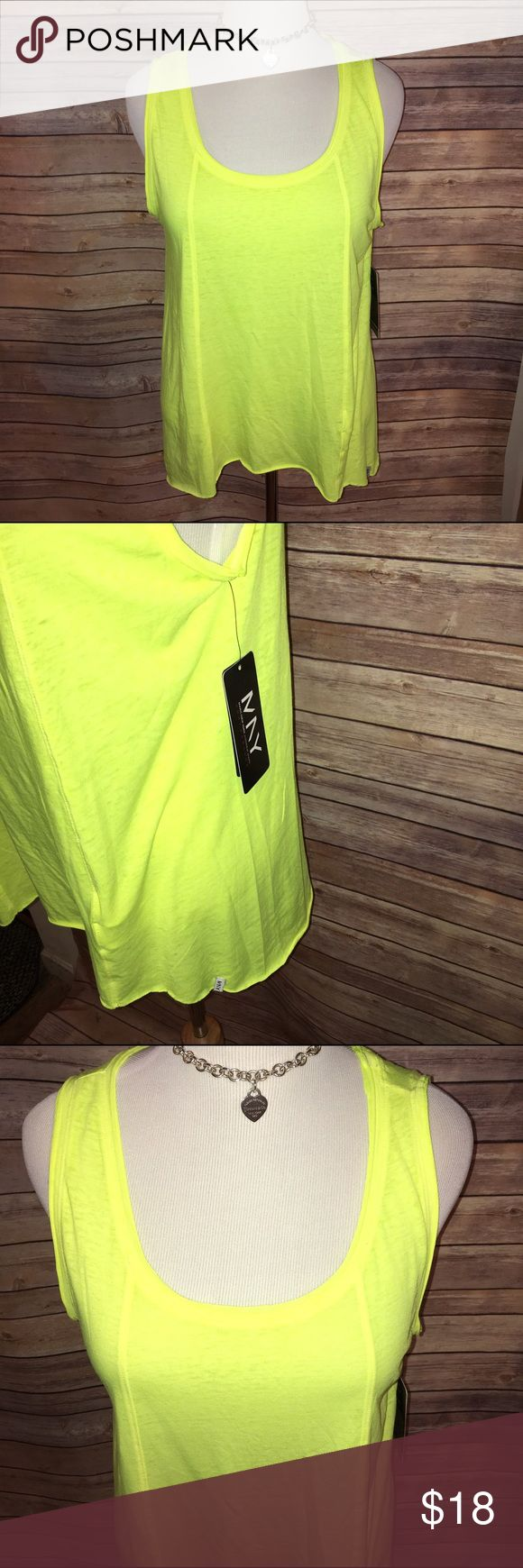BNWT Neon Yellow Marc New York Loose Fit Tank Super colorful, bright and fun! Awesome shade of neon yellow. Super soft and flowy. BNWT, no flaws. Excellent quality and condition. Check out my other listings to bundle and save % 😎! Marc New York Tops Tank Tops