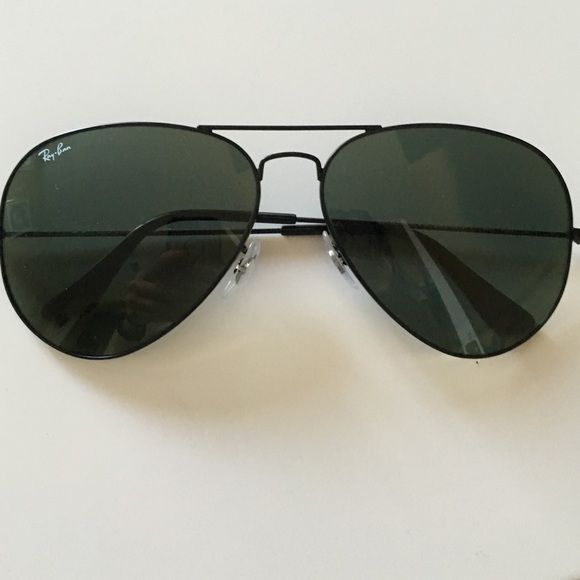 All black Ray Ban Aviators Barely worn and hard to find all black aviators! Genuine Ray Bans Ray-Ban Accessories Sunglasses