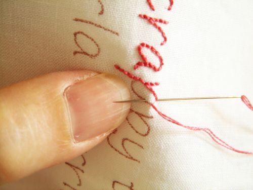 Basic quilt label tutorial (hand-embroider the text, applique it to the quilt)
