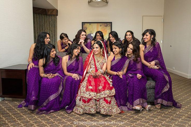 Bridesmaids in purple. Photo by Wedding Documentary