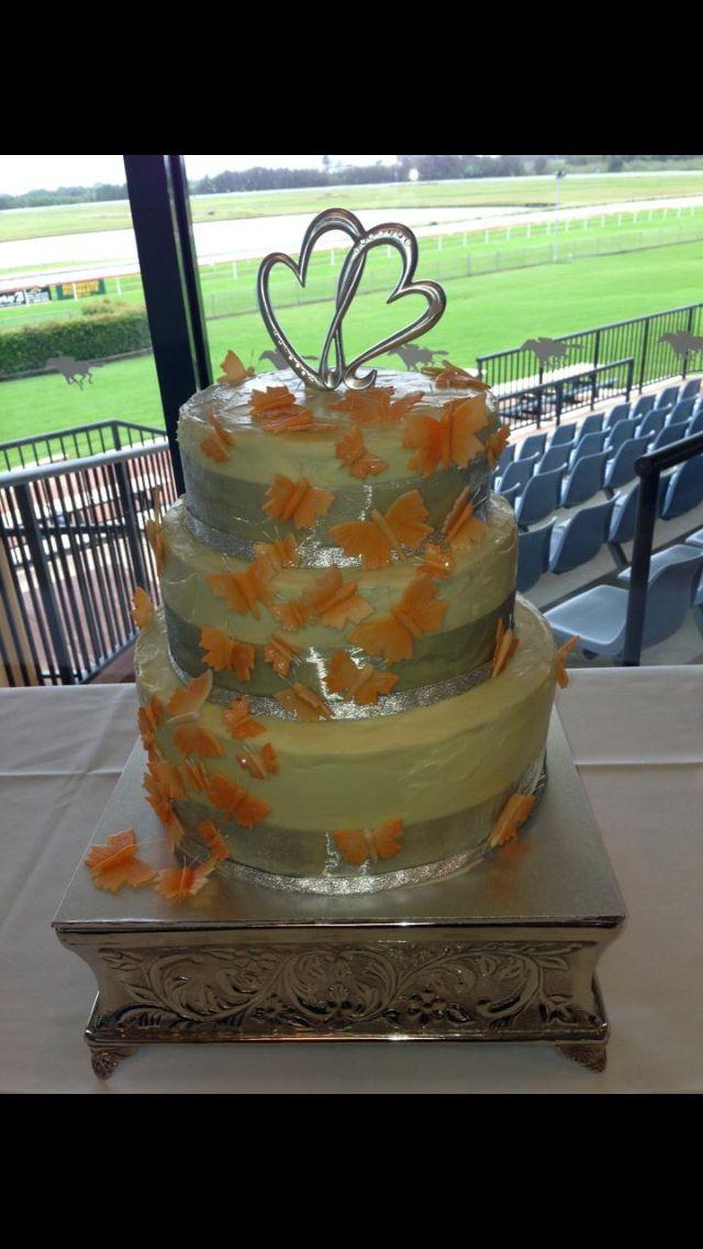 White ganache wedding cake with butterflies.