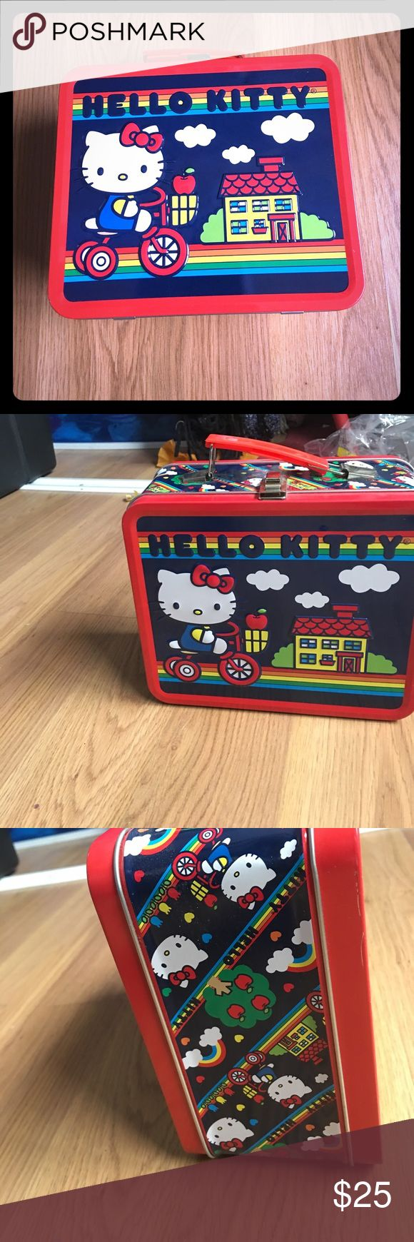 Hello kitty by Sanrio metal lunch box Hello kitty metal lunch box. Great shape. Great to use for lunches, or purse or crafts or to display as decoration sanrio hello kitty Bags