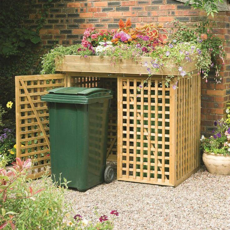 Esta jaula guarda los botes de basura y decorarla con plantas equilibrada el hedor dando un aspecto estético.