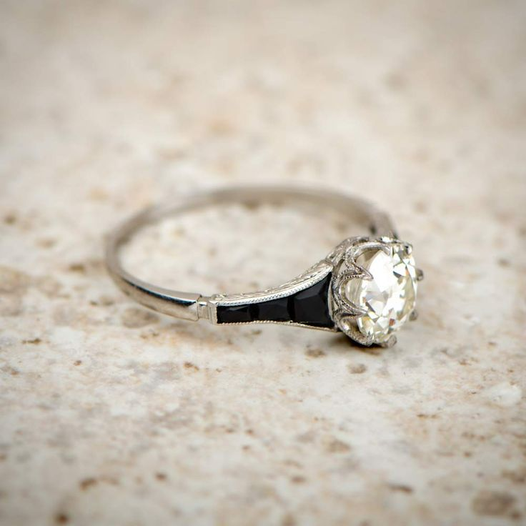 A stunning Antique Onyx and Diamond Engagement Ring, set in a beautiful crown mounting and accented with onyx on both shoulders.