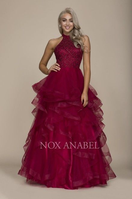 Nox Anabel NXA065 Prom Elegant Halter Neck Open Back Beaded Bodice Defined With Ruffle Layer Tulle. $330.00 ✔Ships in 3-5 Days  ✔All Size  ✔Online Payment Option Back zipper Tulle Material #Nox #Anabel #Prom #Long #V-Neck #Evening #Dress #Detailed #Illusion #Ruffled_Bottom #Sweetheart #Bodice #Strapless #Evening