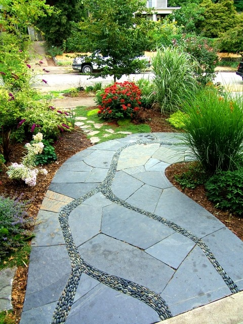 Garden Walkway: soft organic lines of aggregate intersecting abstract sawn flagstone
