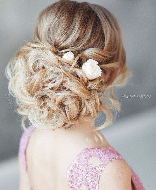 Chic curly updo wedding hairstyle with floral hair accessory; Featured Hairstyle: Elstile