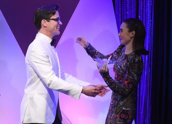 Matt Bomer Photos Photos - Actor Matt Bomer (L) presents the LACOSTE Spotlight Award to honoree Lily Collins onstage at The 19th CDGA (Costume Designers Guild Awards) with Presenting Sponsor LACOSTE at The Beverly Hilton Hotel on February 21, 2017 in Beverly Hills, California. - 19th CDGA (Costume Designers Guild Awards) - Show And Audience