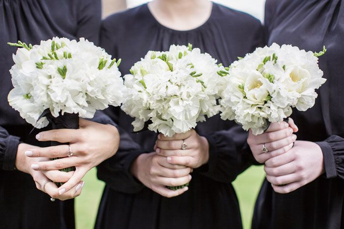 Bridesmaids in black dresses carrying white wedding bouquets! // Flowers by Susan Avery, Photography by Polachinka Photography
