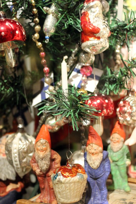 Every Christmas season the toys get their Christmas trees, decorated with old glass decorations. Old gnomes find their ways to the cabinets too...