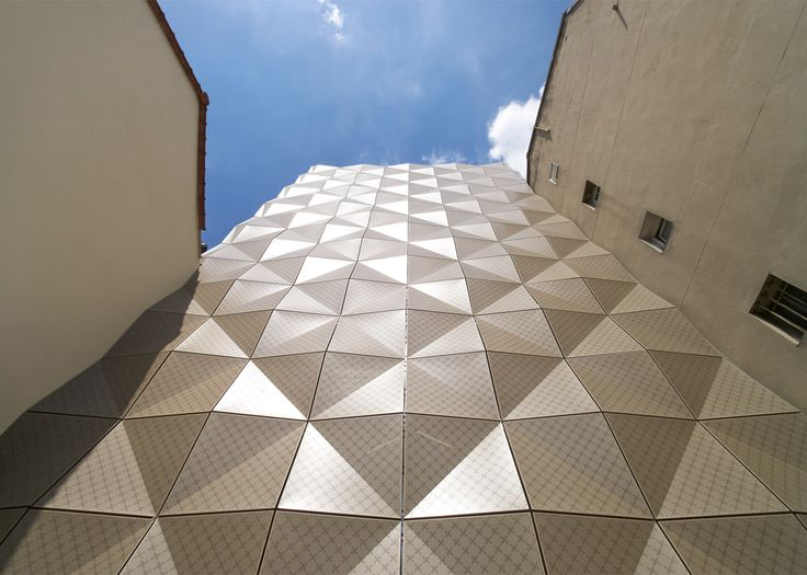 Lankry Architectes' dance school in Paris has patterned cladding, creating a facade of triangular facets