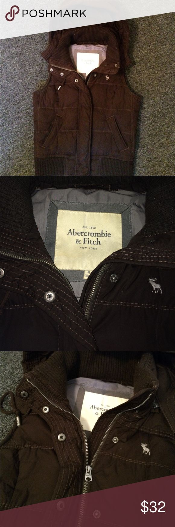 Abercrombie and Fitch Brown Down Vest Size Medium Awesome dark brown vest with a lighter brown stitching. Great condition! Down filled and hooded. Good can be removed. Super deal! Great with a fitted long sleeve T and some jeans. The color is great to match with anything! Abercrombie & Fitch Jackets & Coats Vests