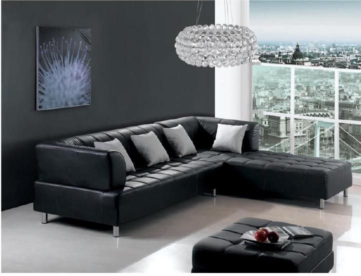 open living room decorating ideas with black leather couch and crystal chandelier