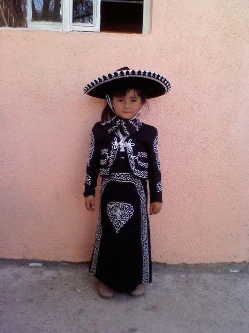 little girl in mariachi costume
