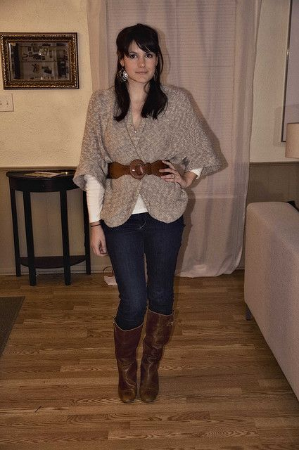 Great cold weather outfit: Long sleeves shirt, jeans, boots, and a large sweater belted to define a waist. Comfy and chic.