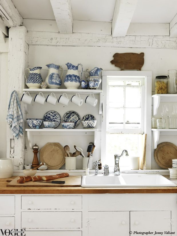 "A collection of blue and white spongeware jugs were the inspiration for the colour palette of the kitchen within Zoe Hoare and Chris Mead's Hamptons home. ""The jugs are almost the same era as the house, so they felt like a perfect fit,"" Hoare says.  From 'American Idyll', a story on page 142 of Vogue Living Nov/Dec 2011.  Photograph by Jonny Valiant."