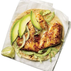 Make food truck-style fish tacos at home using fresh tilapia, avocado, cilantro and corn tortillas, and top with a creamy onion-jalapeno mixture for amazing flavor.