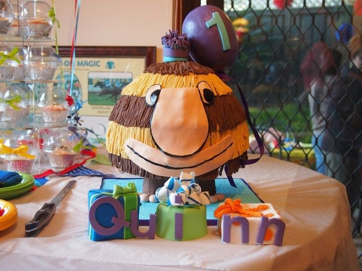at first I thought this was a piñata, and I think that's a great thing to make for a grug party.  but it really is a cake - huge but very well done, especially with the present cakes!