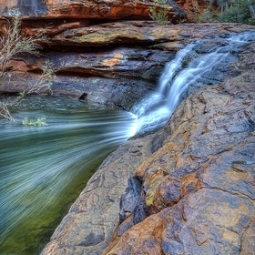 Within Kings Canyon, Northern Territory, Australia, this pretty little falls descends into a lovely pool in an area known as the Garden Of Eden