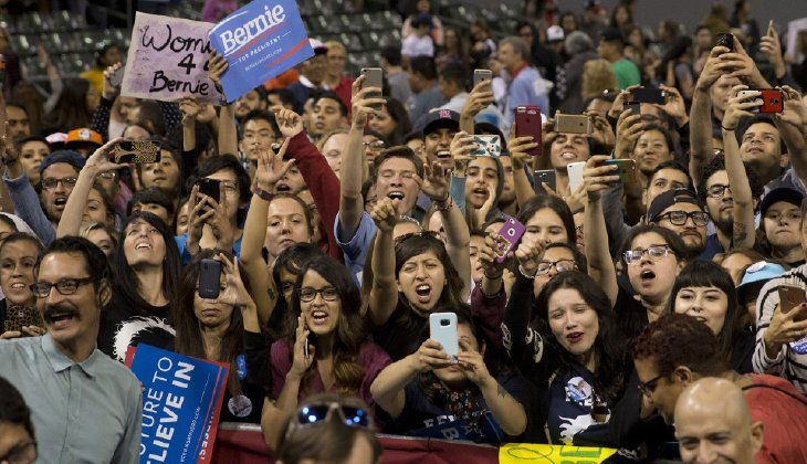 """Sanders said he """"had a very gracious call from Secretary Clinton and congratulated her on her victories tonight,"""" cueing a raucous response from the crowd."""