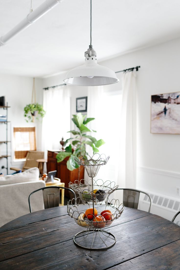 A table from the Brimfield Antique Market sits under a pendent light also found there.