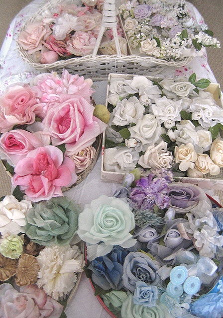 Lovely way to display a millinery flower collection! I would need several hundred baskets!