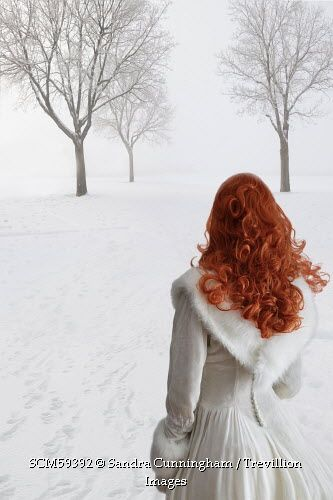 Trevillion Images Woman In White Dress Walking In Snow