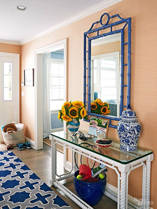 Use bold colours and textures to add interest and contrast to a hallway.