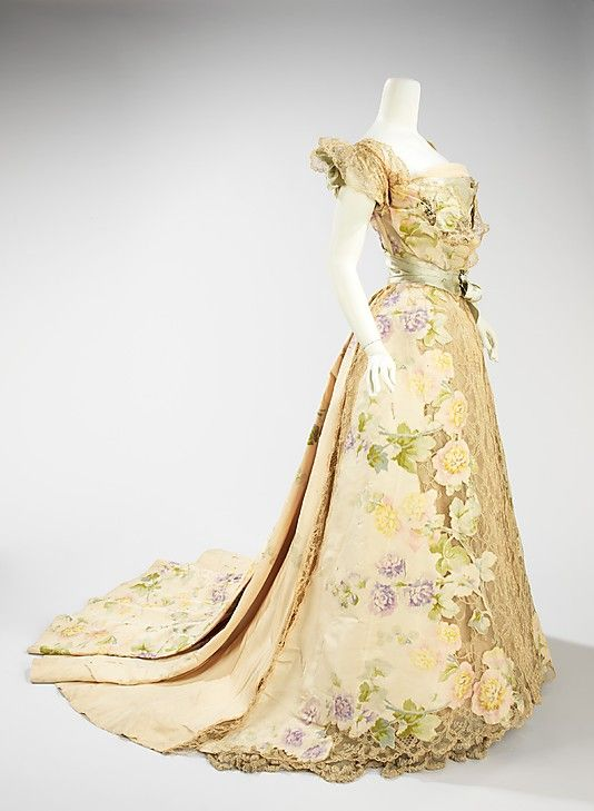 Evening dress, ca. 1858.  Exquisite cutout chine flowers over lace-I can't even fathom how hard that was to make.