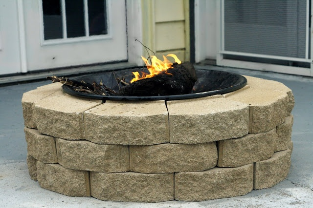 Landscaping bricks + the  bottom of an old charcoal BBQ - creates a great fire pit for the back yard for less about thirty bucks!
