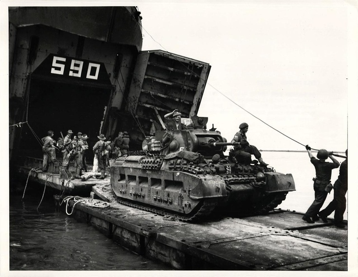 1945- Troops and tank of the 26th Australian Brigade leave U.S. Navy LST which transported them to Tarakan Island, Borneo.