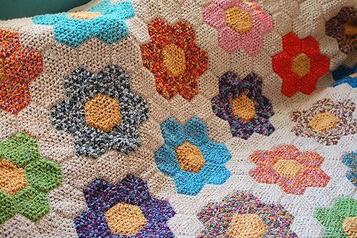 """Summary: (from the book) """"This familiar patchwork quilt pattern can also be made into a most attractive crocheted afghan. Worked up in springtime colors, the afghan brings a flower garden atmosphere to your home all year round. Use any colors you fancy to whip up this quick and easy crochet - a perfect pick-up-and-go project worked one """"petal"""" motif at a time. Another plus for the Grandmother's Flower Garden pattern - it provides an ideal way to use leftover yarn pieces. The finished…"""
