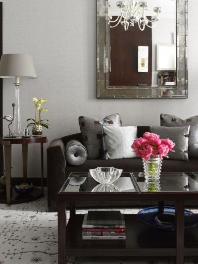 ELLE DECOR - I never would have thought that I would like dark brown with gray but the sofa fabric has just enough red in the undertone to make it work! Very nice.