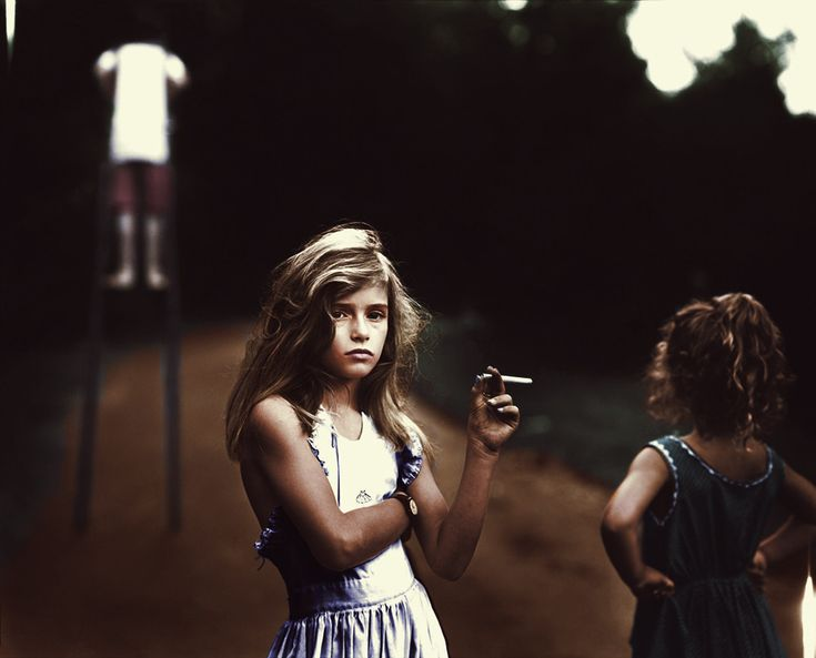 Sally Mann's daughter, Jessie Mann, holding a Candy Cigarette in 1989 (colorized)