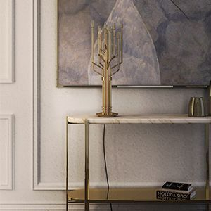 Craig is a narrow console table with chic polished brass legs and structure, featuring a top made of verde guatemala marble and a gallery shelf for additional storage space in your living room or entry way.  See more: https://goo.gl/XSYbB6