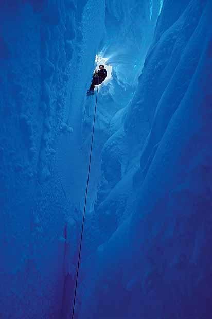A climber descends into a glacier in Halley Bay, Antarctica.