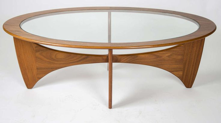 British G-Plan oval shaped teak with inset glass top coffee table. A ...