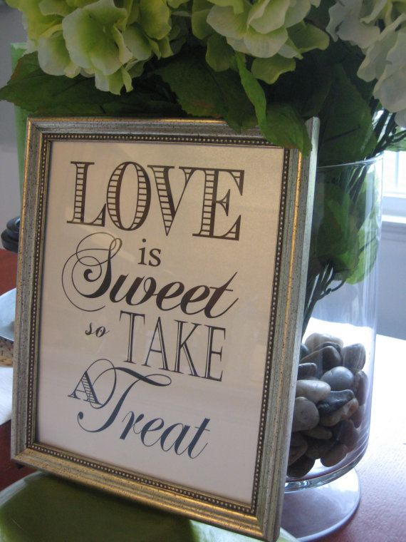"Signs for the reception - ""Love is sweet so enjoy our favorite treats"" - on a chalkboard"