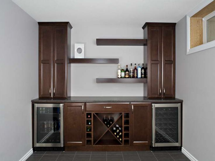 Elaborate Wet Bar Design With Brown Cabinetry, Staggered Open Shelves, Wine  Racks And Beverage