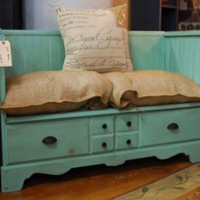 Bench made from an old dresser. Take out top drawers, paint / finish as you wish. Add pillows of choice.