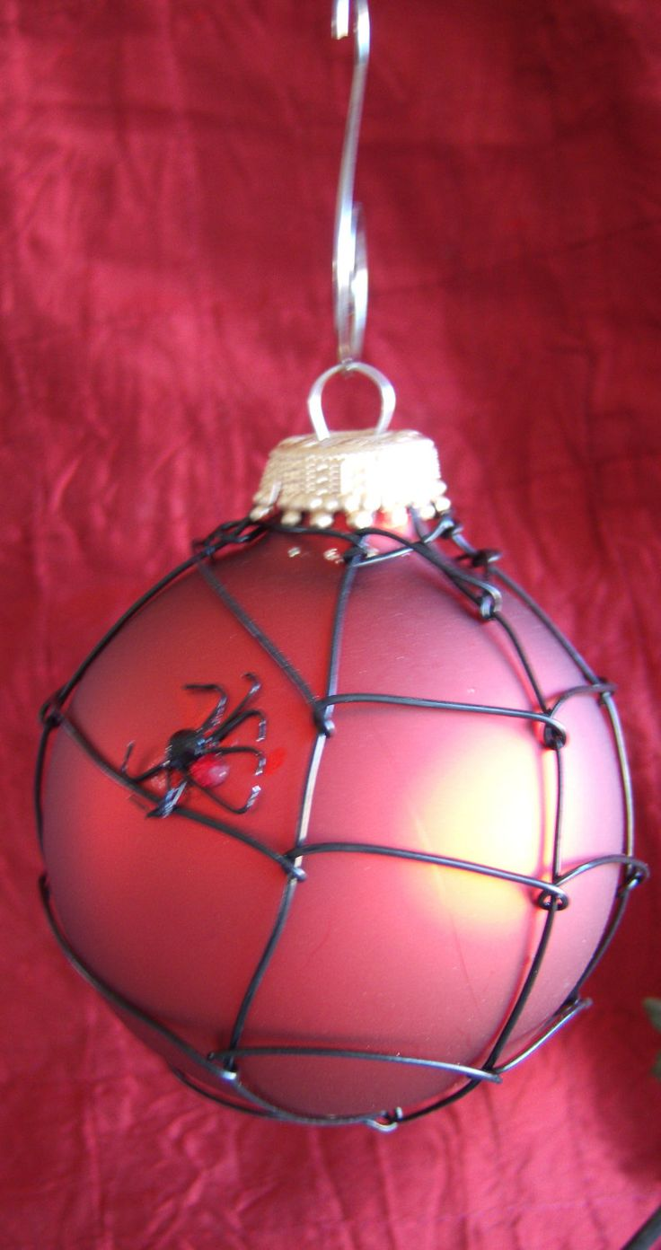 Spidery - five bucks on etsy - or make your own with black puff paint on red or silver ornaments
