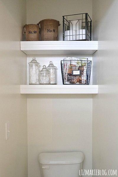 Transform a bathroom toilet room with shelves. So simple & affordable for a big impact! DIY Floating Bathroom Shelves - lizmarieblog.com