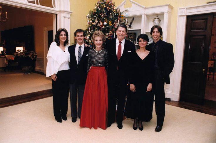 The Reagan Family Christmas portrait by the White House residence Christmas tree: (from left to right) Patti Davis, Paul Grilley, Nancy Reagan, President Reagan, Doria Reagan, Ron Reagan. 12/25/83.