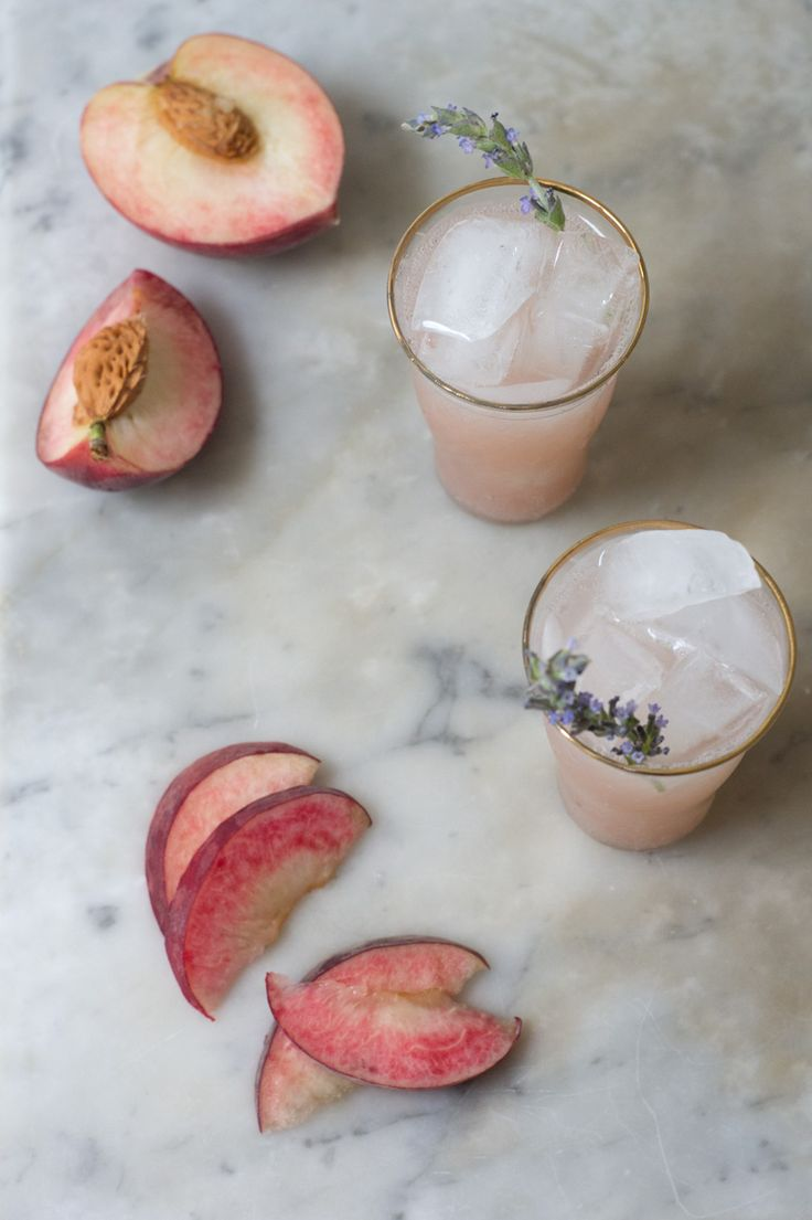 A beautiful summer soda made with white peach puree, maple syrup, sparkling water, and a sprig of fresh lavendar.