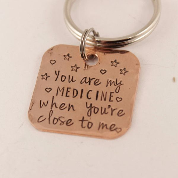 """This listing is for ONE copper keychain that states """"You are my medicine when you're close to me"""", a lyric I love from the Gorillaz song """"On Melancholy Hill"""". Specifications: - Each keychain is 1 1/8"""""""